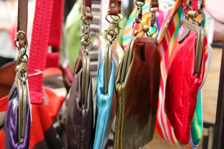 Ladies leather purses and bags displayed at a market Stock Photo