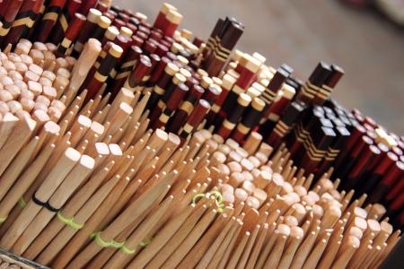 Retail, market basket of many sets of wooden chopsticks