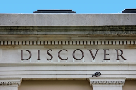 Word Discover embedded into educational building with sleeping pidgeon Editorial