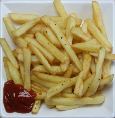 fattening: Square Ceramic Plate of Cooked french fries