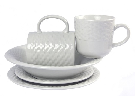 A Stack of White on White Crockery with plates and cups Stock Photo