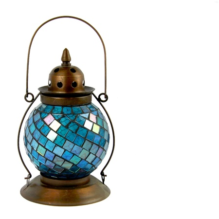 Blue Glass and Bronze Lantern for burning Candles Stock Photo
