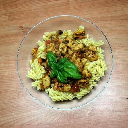 Vegetarian Fake Chicken and Vegetable Pasta in a glass bowl