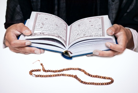 muslim pray: Girl reading the Koran