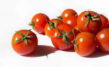 Ripe tomatoes on the white background Stock Photo - 12653569