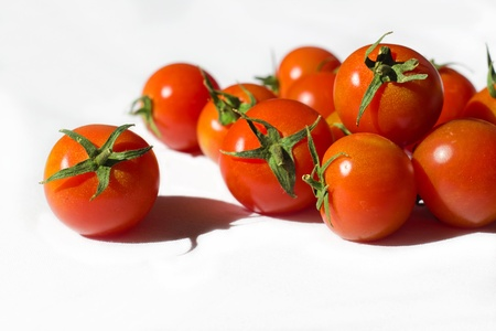 Ripe tomatoes on the white background Stock Photo - 12653571