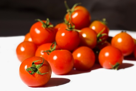 Ripe tomatoes on the white background Stock Photo - 12653572