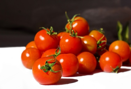 Ripe tomatoes on the white background Stock Photo - 12653574