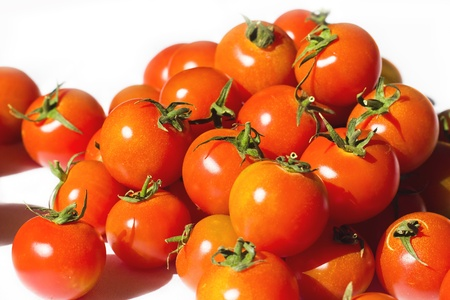 Ripe tomatoes on the white background Stock Photo - 12653590