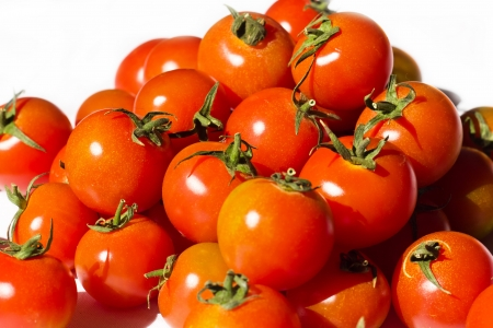 Ripe tomatoes on the white background Stock Photo - 12653579