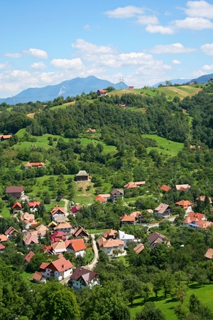 View of a village in Carpathian mountains photo