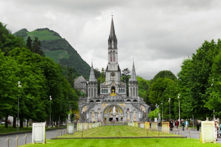 rood: center of pilgrimage to famous cathedral in Lourdes, France   Stock Photo