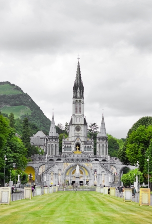 center of pilgrimage to famous cathedral in Lourdes, France   Фото со стока