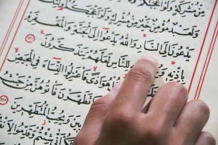 quran: Student studying Islam in Mosque Stock Photo