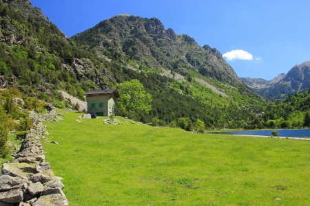 traditional climbing: view of lake Llebreta in national park Aiguestortes in Catalonia