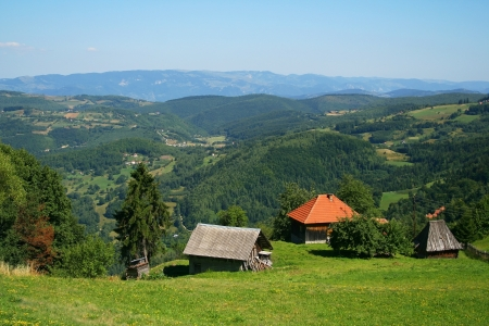 lonely huts in Serbian mountains photo