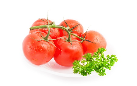 domates: Red ripe tomatoes with parsley on plate isolated on white background Stock Photo