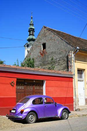 purple car: purple vintage car on the street