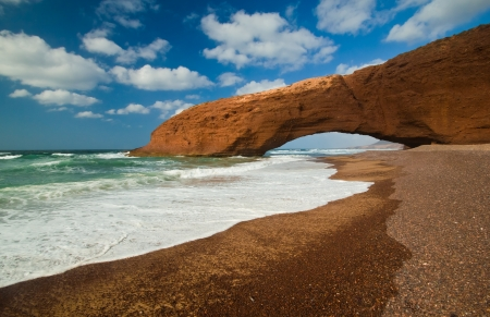 huge red cliffs with arch on the beach Legzira  Morocco
