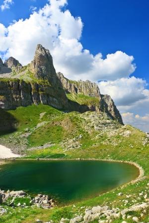 albania: Amazing view of mountain lake Mjelsave in Albanian Alps, national park Theth, Albania Stock Photo