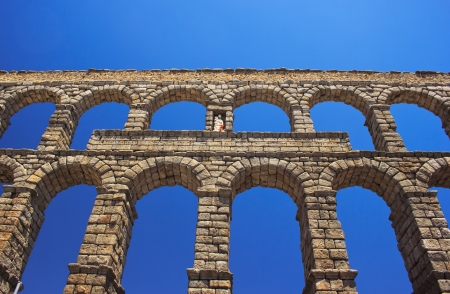 segovia: Ancient aqueduct in historic center of Segovia, Spain