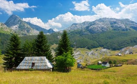 View of family farm on countriside near Rikavacko lake in Komovi mountains, Montenegro photo