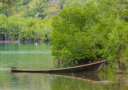 shallop: View of old holey boat on the bay of Andaman sea at Tarutao island Stock Photo