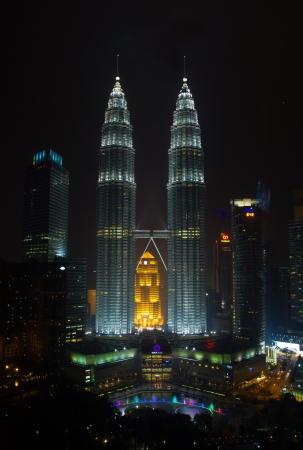 KUALA LUMPUR, MALAYSIA - JANUARY 26  Petronas Twin Towers at night on January 26, 2014 in Kuala Lumpur  Petronas Twin Towers most famous shopping center in Kuala Lumpur
