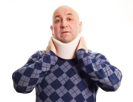 Middle age man with neck troubles using a cervical collar isolated on white  photo