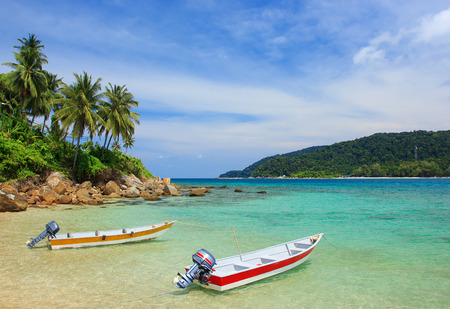 speedboats: Serene view of the speedboats on the beach, Perhentian Island