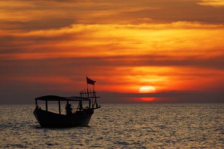 shallop: Amazing view of fishing boat at sunset Stock Photo