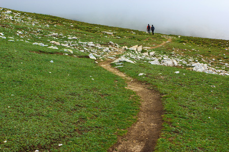rocky mountain national park: Couple of travelers walking on a trail in Uludag Mountains Stock Photo