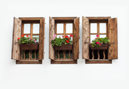 flower boxes: Three windows with flower pot on white wall