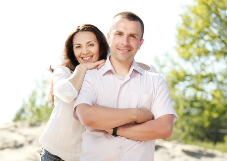 russian man: Portrait of happy smiling couple outdoor