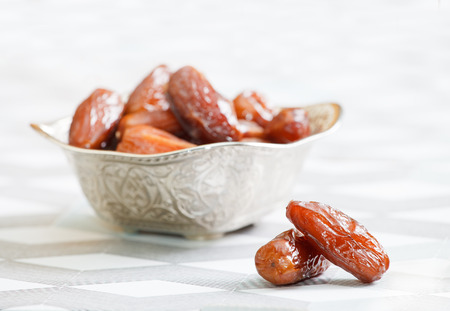 Beautiful bowl full of date fruits symbolizing Ramadan