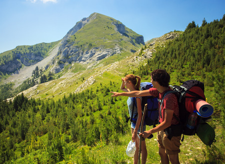 montenegro: Beautiful couple with backpacks traveling in Visitor Mountains, Montenegro