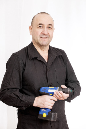 worker man: Middle aged man worker with screwdriver on a white background