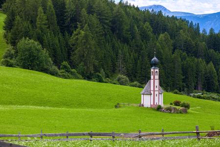 Famous San Giovanni church in Ranui, Santa Magdalena, Dolomite Alps, Italy