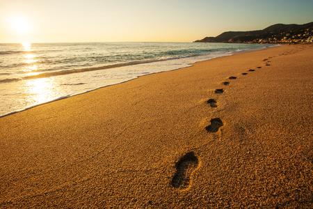 Footprints on the sandy beach