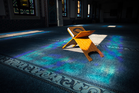Quran - holy book of muslims, scene in the mosque at Ramadan time