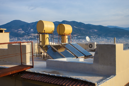 Solar panels and water heating system on the roof
