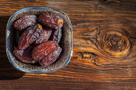 Beautiful bowl full of date fruits symbolizes Ramadan (Holy month of Muslims)