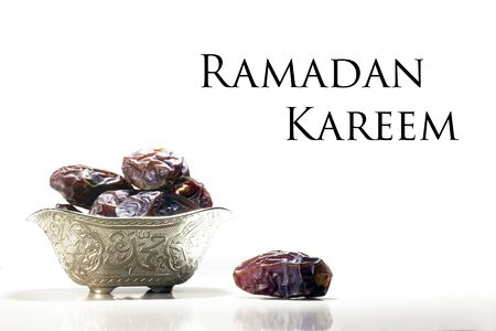 Beautiful bowl full of date fruits symbolizing Ramadan, White background