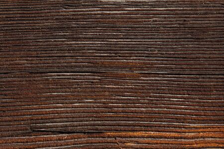 Close up of a brown wooden wallboard textured background Stock Photo
