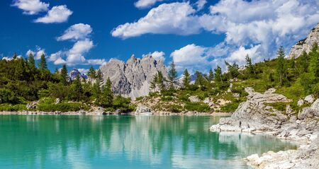 Amazing view of Sorapis lake with unusual color of water. Lake located in Dolomite Alps, Italy