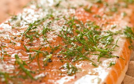broiling: Fresh fish fillet ready for broiling, prepared with garlic, dill, pepper and other spices.
