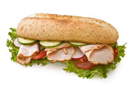Roasted turkeychicken breast sandwich with lettuce, tomatoes, cucumbers and radishes isolated on white photo