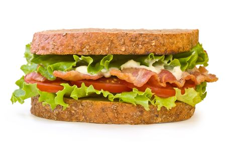 Whole wheat toasted BLT (Bacon, Lettuce, Tomato) sandwich with mayonnaise isolated on white background
