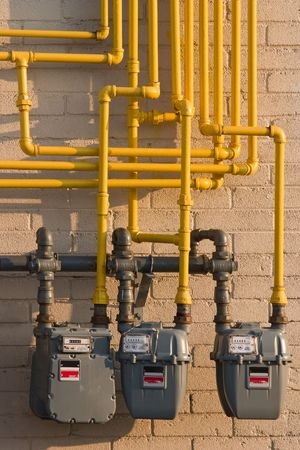 gas distribution: Maze of pipes and natural gas meters. Concept for raising energy or utility costs, evironmental concerns or advantages of alternative heating methods.