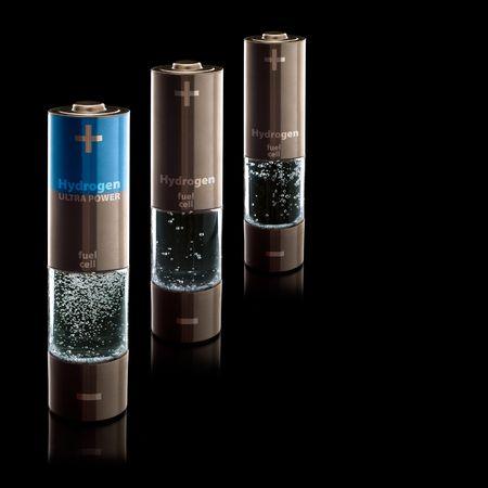 hidrogeno: Concepto para un hogar de hidr�geno pilas de combustible. Pilas AA con compartimiento lleno de l�quido burbujeante.